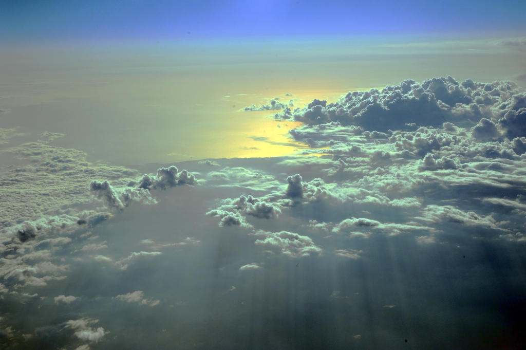 Entrance to heaven, cloudscape over Oregon state and the Pacific Ocean, from Alaska Airlines jet, West Coast, USA by Wonderlane licensed under CC BY 2.0