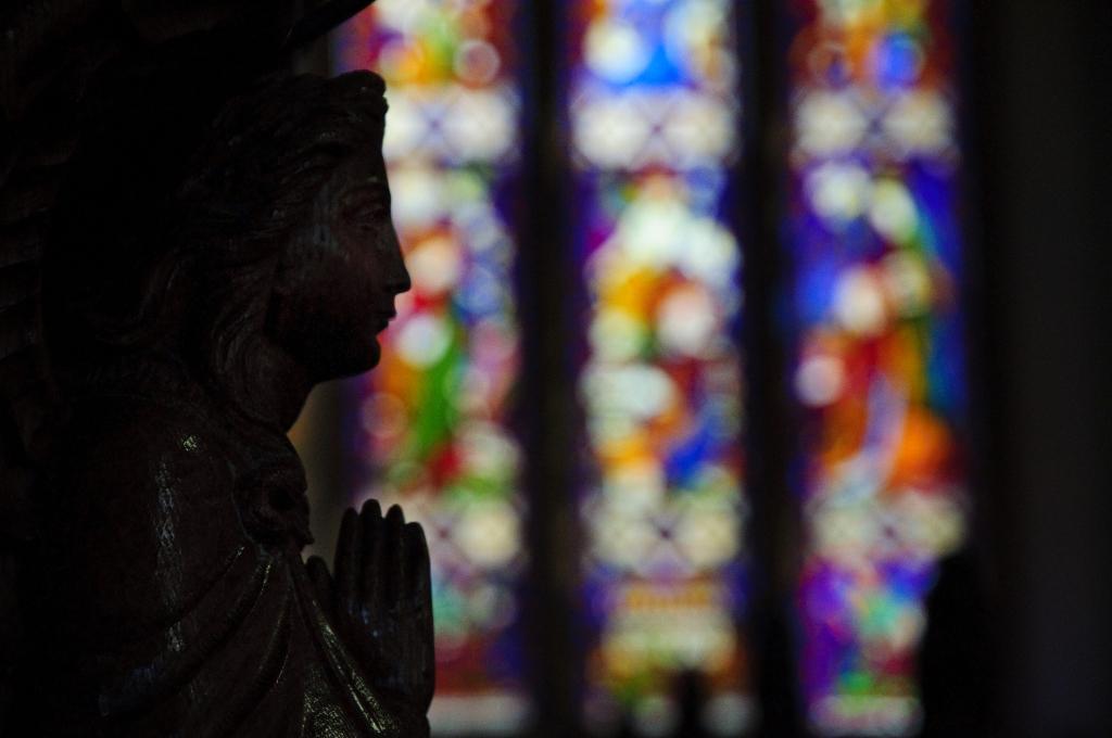 Praying in Church by GB_1984 licensed under CC BY 2.0